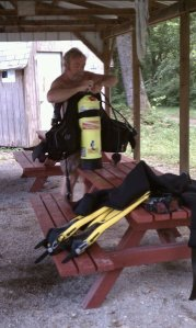 Scuba Steve Gardner gets his diving gear ready at an Indiana quarry.