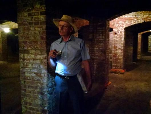 Indiana Landmarks' tour guide and volunteer Craig Barker shares a story in the catacombs