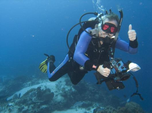 "Scuba Steve Gardner gives the ""go up"" sign. Diving has a different language down below."